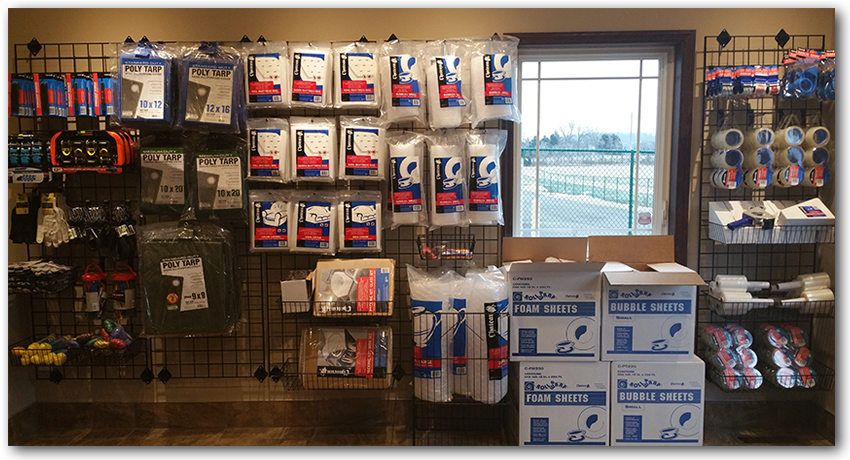 Safeguard Storage of Wisconsin | Accessories & Supplies Available | Wall of Products in Office